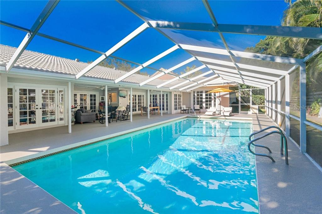 Perfect for large family parties and entertaining guests all year long. - Single Family Home for sale at 4557 Camino Real, Sarasota, FL 34231 - MLS Number is A4457740