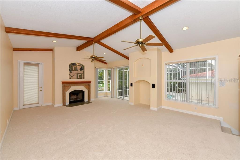 500 square foot family room. Plenty of space to make it whatever you want! Fireplace adds to the feel. - Single Family Home for sale at 1332 Quail Dr, Sarasota, FL 34231 - MLS Number is A4458756