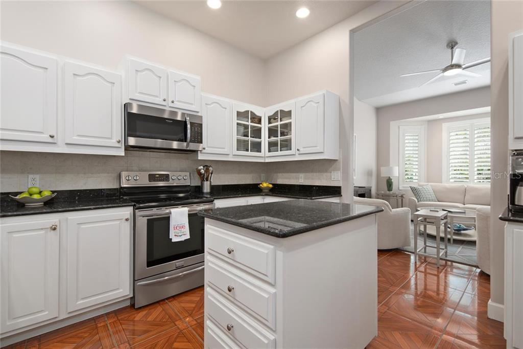 Kitchen to living room - Single Family Home for sale at 448 Baynard Dr, Venice, FL 34285 - MLS Number is A4459566