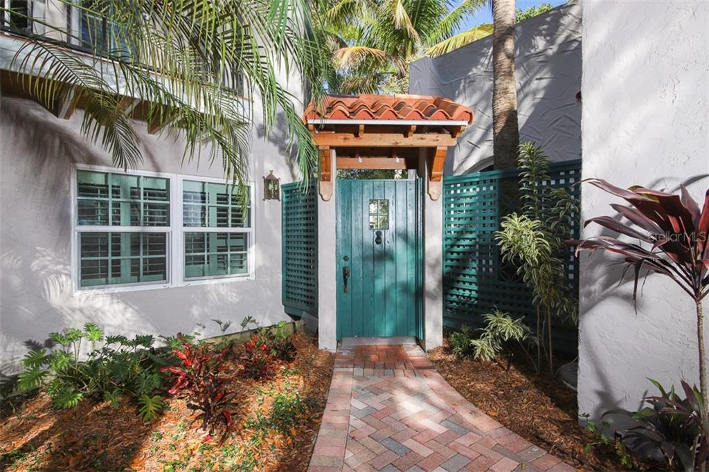 Original door going into courtyard - Single Family Home for sale at 3838 Flores Ave, Sarasota, FL 34239 - MLS Number is A4461669