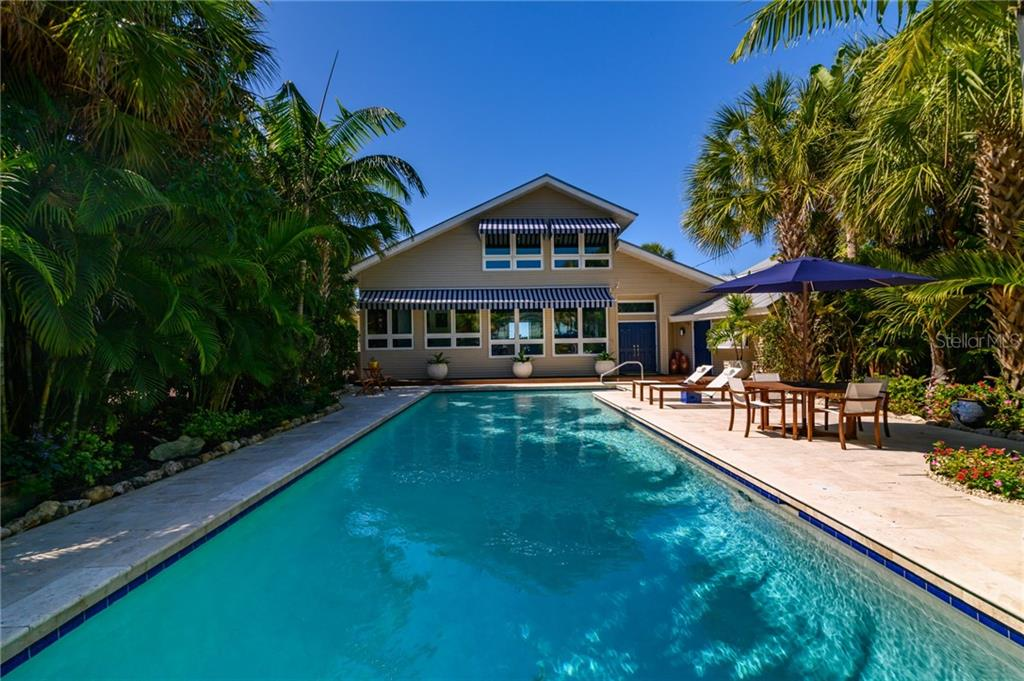 Salt Water Lap Pool to Residence - Single Family Home for sale at 7340 Point Of Rocks Rd, Sarasota, FL 34242 - MLS Number is A4461841