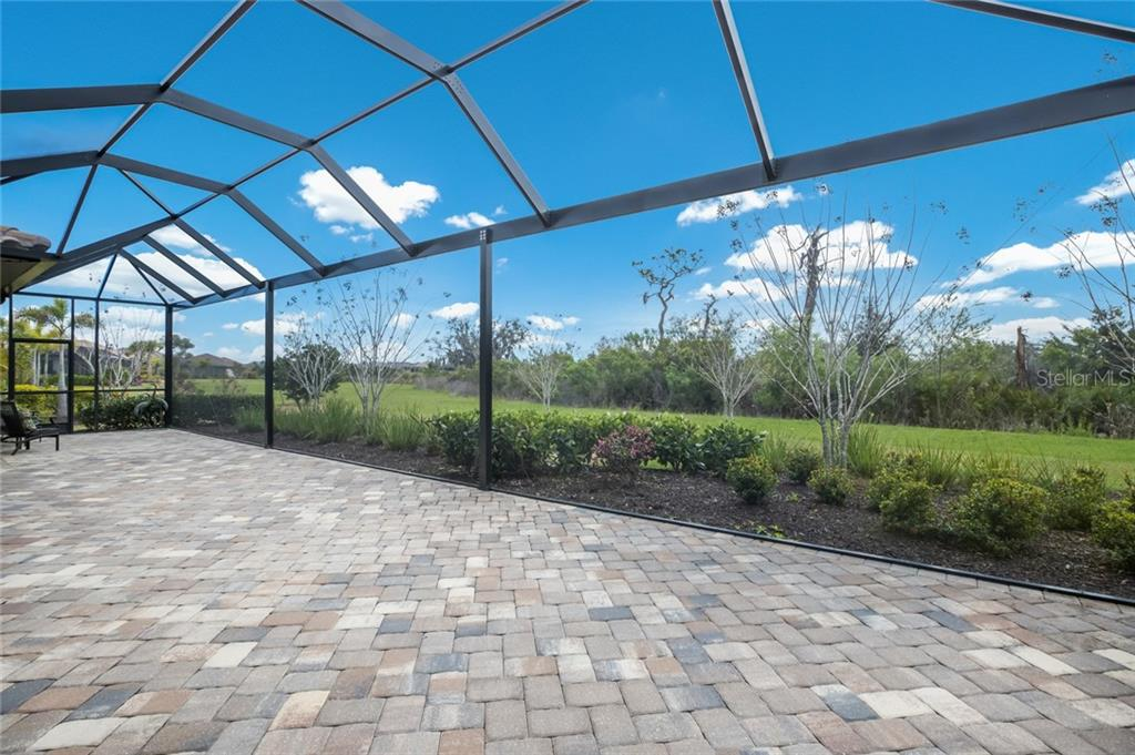Extended Lanai with clear view screen and pre-plumbed for a pool - Single Family Home for sale at 16210 Castle Park Ter, Lakewood Ranch, FL 34202 - MLS Number is A4461861