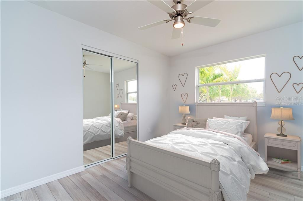 Bedroom #1 Virtually Staged - Single Family Home for sale at 5057 Bell Meade Dr, Sarasota, FL 34232 - MLS Number is A4461883