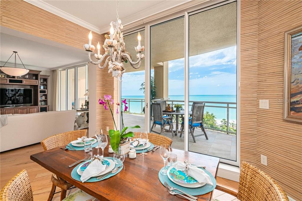 eat in café style kitchenette, out door terrace seating area - Condo for sale at 1300 Benjamin Franklin Dr #805, Sarasota, FL 34236 - MLS Number is A4462621