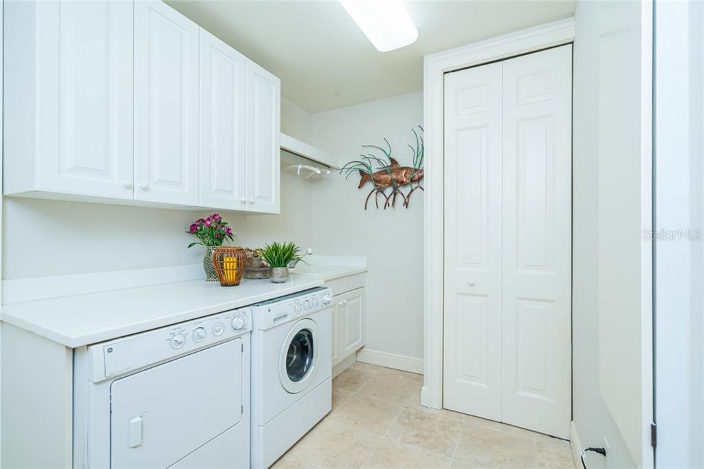 laundry room - Condo for sale at 1300 Benjamin Franklin Dr #805, Sarasota, FL 34236 - MLS Number is A4462621