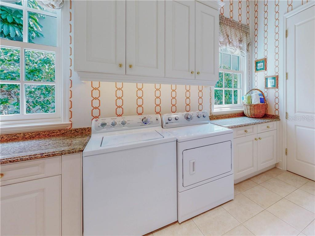 The huge laundry room has additional storage cabinets and closet space. - Single Family Home for sale at 1590 Harbor Sound Dr, Longboat Key, FL 34228 - MLS Number is A4463437