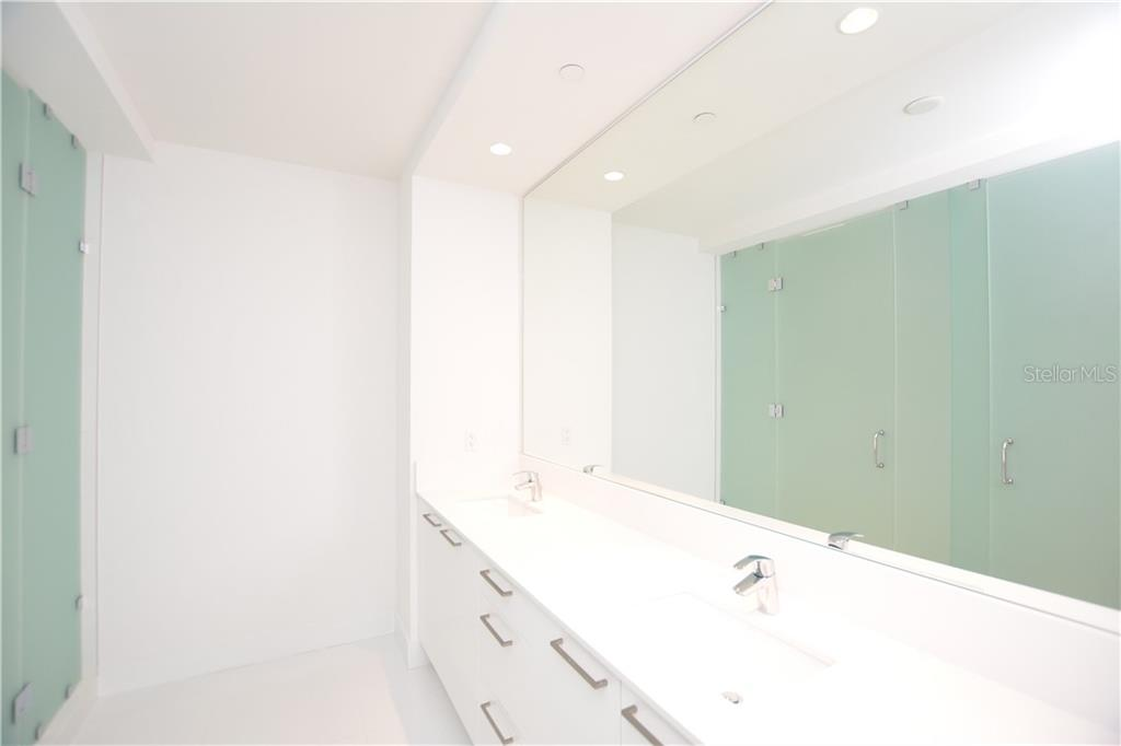 Master ensuite offers dual sinks, quartz countertops & etched glass shower doors. - Condo for sale at 111 S Pineapple Ave #610, Sarasota, FL 34236 - MLS Number is A4463717