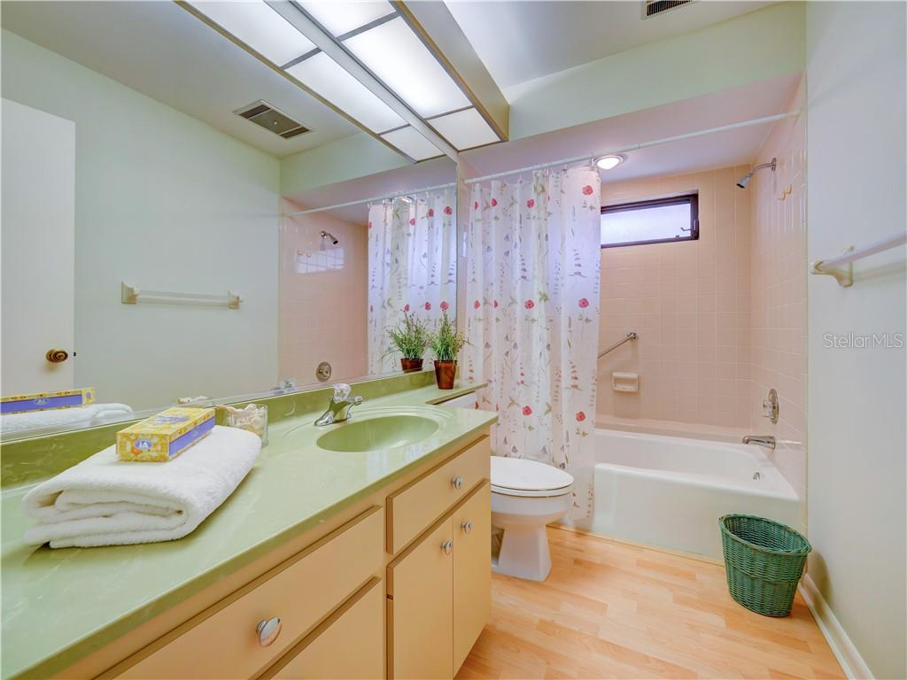 1st of Two Bathrooms w/Tub and shower accessible from living area - Villa for sale at 4335 Rum Cay Cir, Sarasota, FL 34233 - MLS Number is A4463762