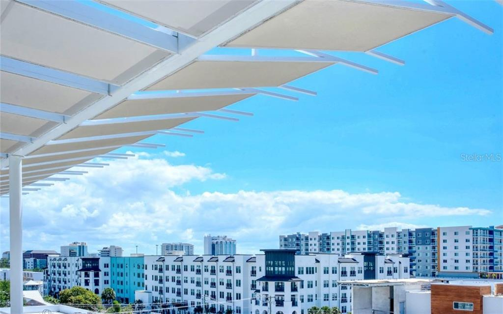 Rooftop amenity sun shelves offer shade as your relax. - Condo for sale at 1350 5th Street #104, Sarasota, FL 34236 - MLS Number is A4463799