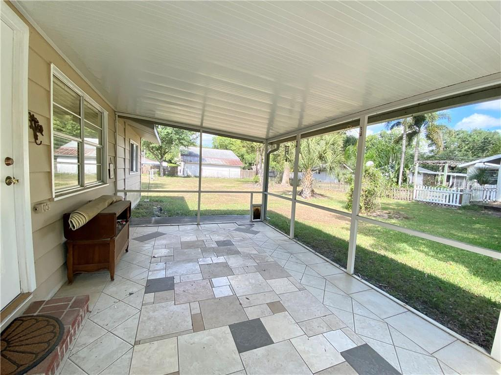 Lanai, view to the backyard. - Single Family Home for sale at 4300 Eastern Pkwy, Sarasota, FL 34233 - MLS Number is A4464200
