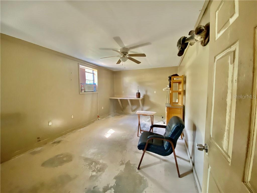 Inside the air conditioned work space.  This space was built into the garage. - Single Family Home for sale at 4300 Eastern Pkwy, Sarasota, FL 34233 - MLS Number is A4464200