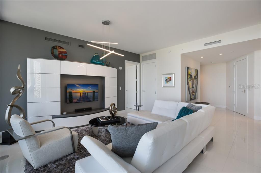 Custom light fixtures complete the scene in this perfectly-done home. - Condo for sale at 1155 N Gulfstream Ave #708, Sarasota, FL 34236 - MLS Number is A4466759