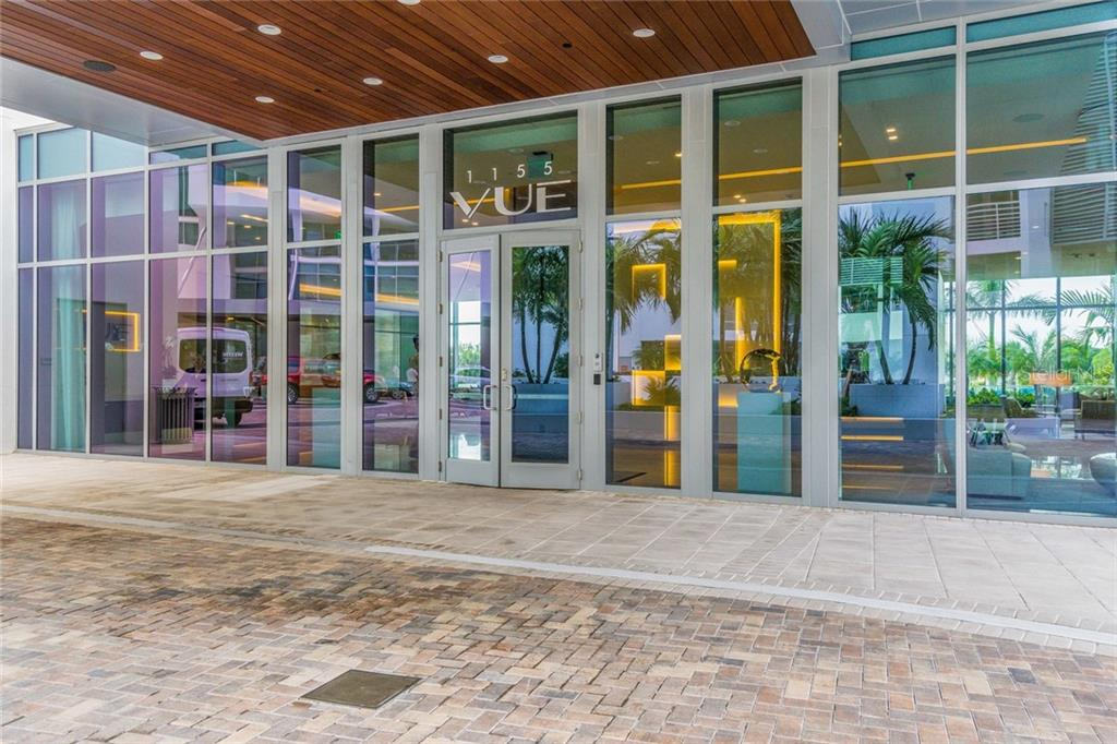 Main building entrance where residents are greeted by the valet - Condo for sale at 1155 N Gulfstream Ave #708, Sarasota, FL 34236 - MLS Number is A4466759