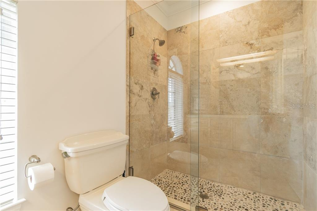 En suite bath for bedroom 4 - Single Family Home for sale at 1418 John Ringling Pkwy, Sarasota, FL 34236 - MLS Number is A4467093