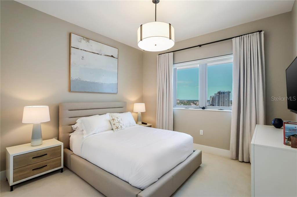 The second bedroom also has views of Sarasota Bay and features its own full bath. - Condo for sale at 1155 N Gulfstream Ave #1404, Sarasota, FL 34236 - MLS Number is A4467921