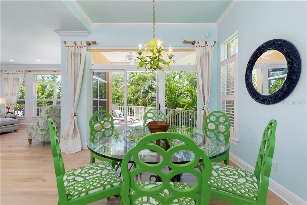 Dining and covered balcony - Single Family Home for sale at 97 52nd St, Holmes Beach, FL 34217 - MLS Number is A4468151
