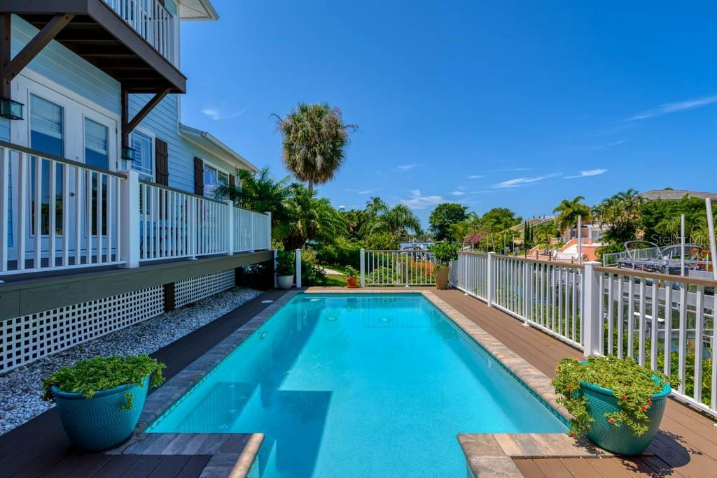 Saltwater pool overlooking the canal - Single Family Home for sale at 605 N Point Dr, Holmes Beach, FL 34217 - MLS Number is A4469001