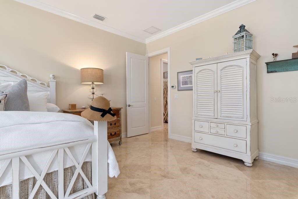 Ground floor master bedroom suite - Single Family Home for sale at 605 N Point Dr, Holmes Beach, FL 34217 - MLS Number is A4469001