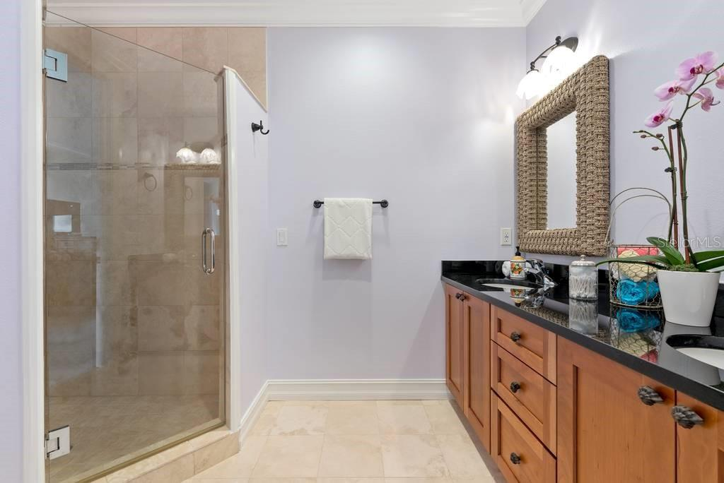 Second master en suite bath with dual sinks and walk in shower - Single Family Home for sale at 605 N Point Dr, Holmes Beach, FL 34217 - MLS Number is A4469001