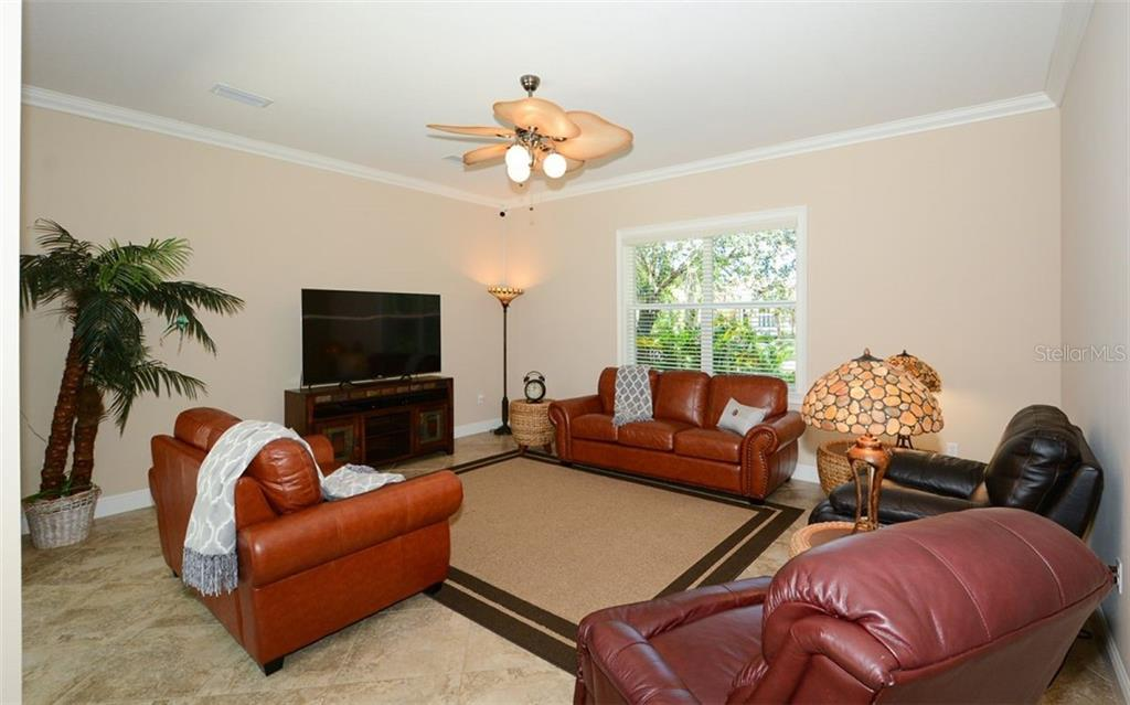 Large family room off the kitchen - Single Family Home for sale at 1623 Jacana Ct, Nokomis, FL 34275 - MLS Number is A4470679