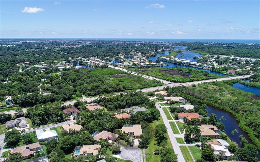 Aerial view of the home and beautiful community of Laurel Landing Estates - Single Family Home for sale at 1623 Jacana Ct, Nokomis, FL 34275 - MLS Number is A4470679