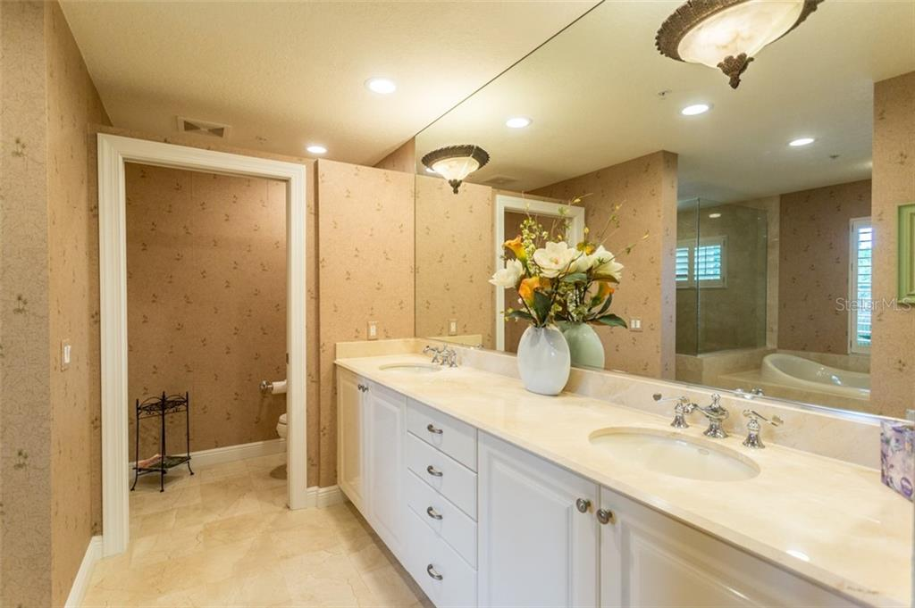Master Bathroom with marble throughout - Condo for sale at 1308 Old Stickney Point Rd #W24, Sarasota, FL 34242 - MLS Number is A4471155