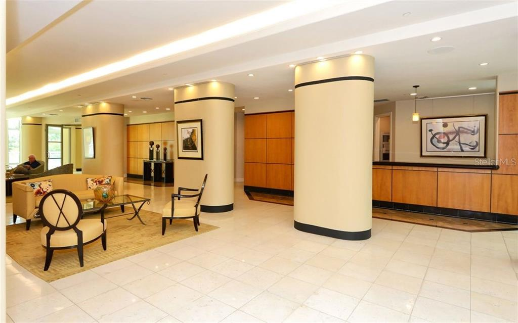 Sarabande Lobby with Concierge Desk - Condo for sale at 340 S Palm Ave #Pl1, Sarasota, FL 34236 - MLS Number is A4471687
