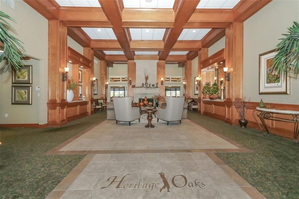 Entrance and lobby.  Main dining room straight ahead, 19th hole to the right, meeting and administration rooms to the left. - Villa for sale at 4590 Samoset Dr, Sarasota, FL 34241 - MLS Number is A4471881