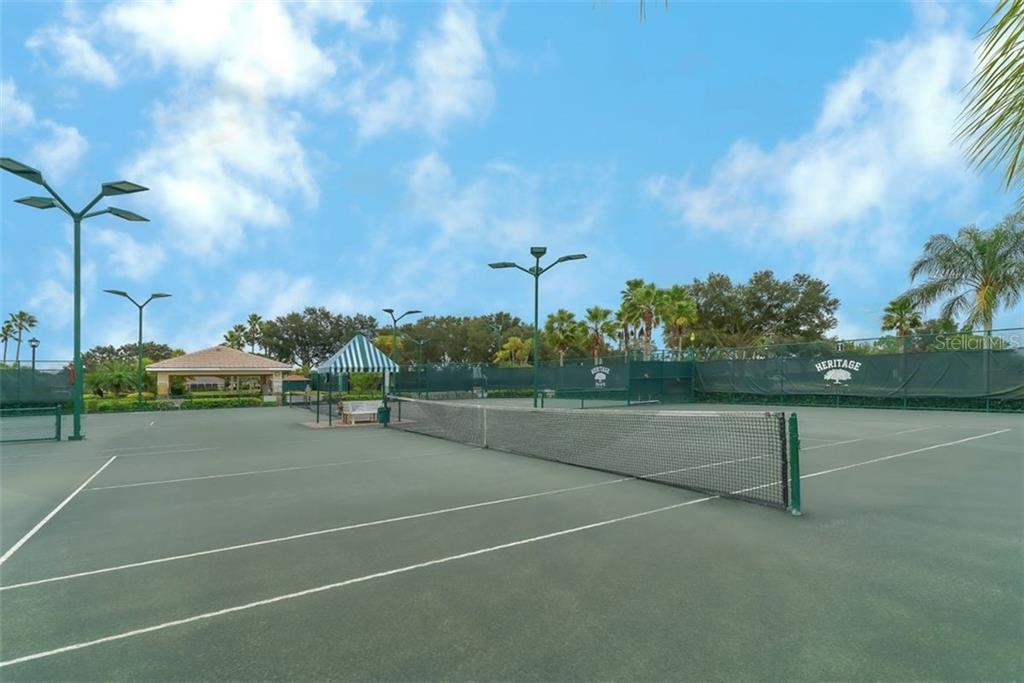 Har tru surface and lighted tennis courts. - Villa for sale at 4590 Samoset Dr, Sarasota, FL 34241 - MLS Number is A4471881