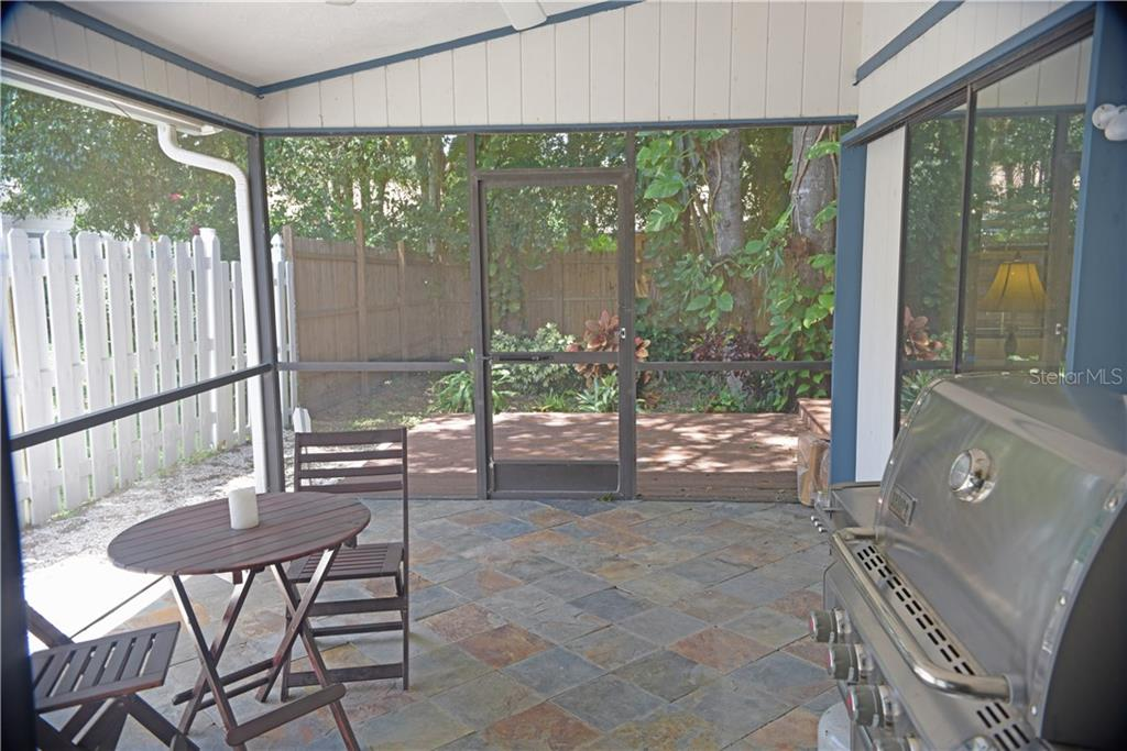 Slate tile floor, Screened Lanai - Single Family Home for sale at 3921 Warren St, Sarasota, FL 34233 - MLS Number is A4474011