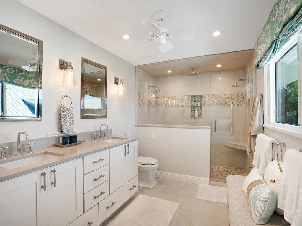 Master bathroom with dual sinks and shower - Single Family Home for sale at 500 Beach Rd #1, Sarasota, FL 34242 - MLS Number is A4474527