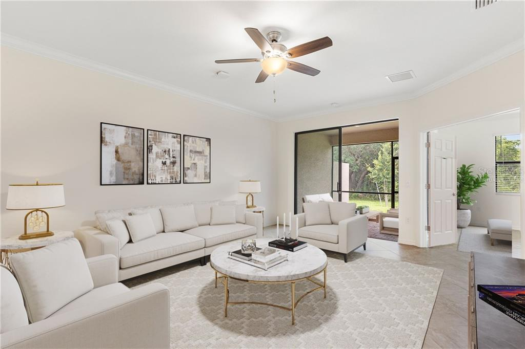 virtually staged living room, lanai, and master bedroom - Villa for sale at 12627 Garibaldi Ln, Venice, FL 34293 - MLS Number is A4474568