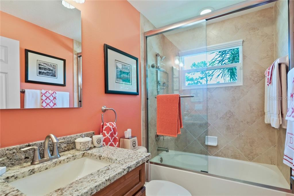 Upstairs bathroom for bedrooms #1 and #2 - Single Family Home for sale at 1907 Clematis St, Sarasota, FL 34239 - MLS Number is A4474600