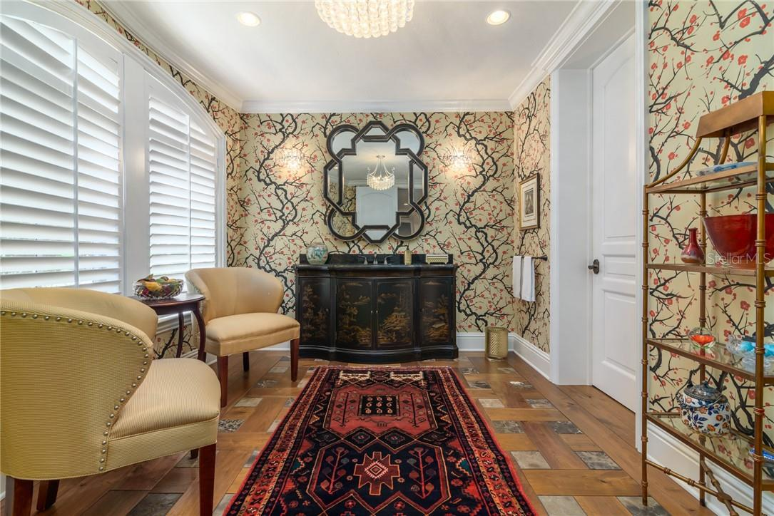 The most extravagant restroom, featuring a separate compartmented toilet room, features custom painted wallpaper, inlaid marble and walnut flooring and drama! - Single Family Home for sale at 1807 Oleander St, Sarasota, FL 34239 - MLS Number is A4475067