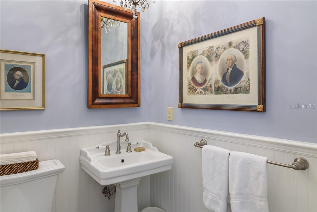 Calming powder bath off kitchen features beadboard and chair rail and all white plumbing fixtures and brushed nickel faucets. - Single Family Home for sale at 1807 Oleander St, Sarasota, FL 34239 - MLS Number is A4475067