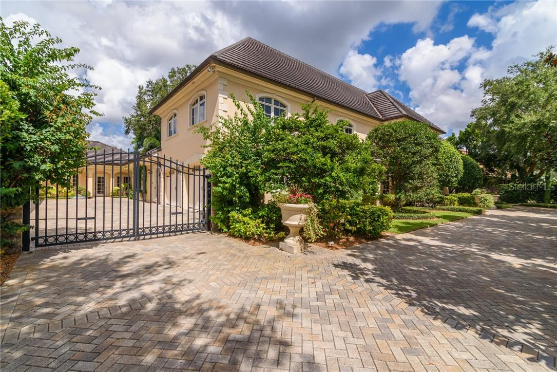 French chateau is walled and gated with brick paver driveway and motor court leading to a total of 5 car garages. - Single Family Home for sale at 1807 Oleander St, Sarasota, FL 34239 - MLS Number is A4475067