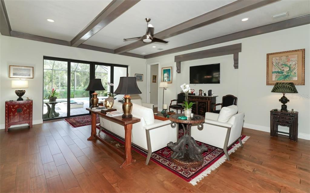 Wood floors complement the style of the home - Single Family Home for sale at 3538 Trebor Ln, Sarasota, FL 34235 - MLS Number is A4475545