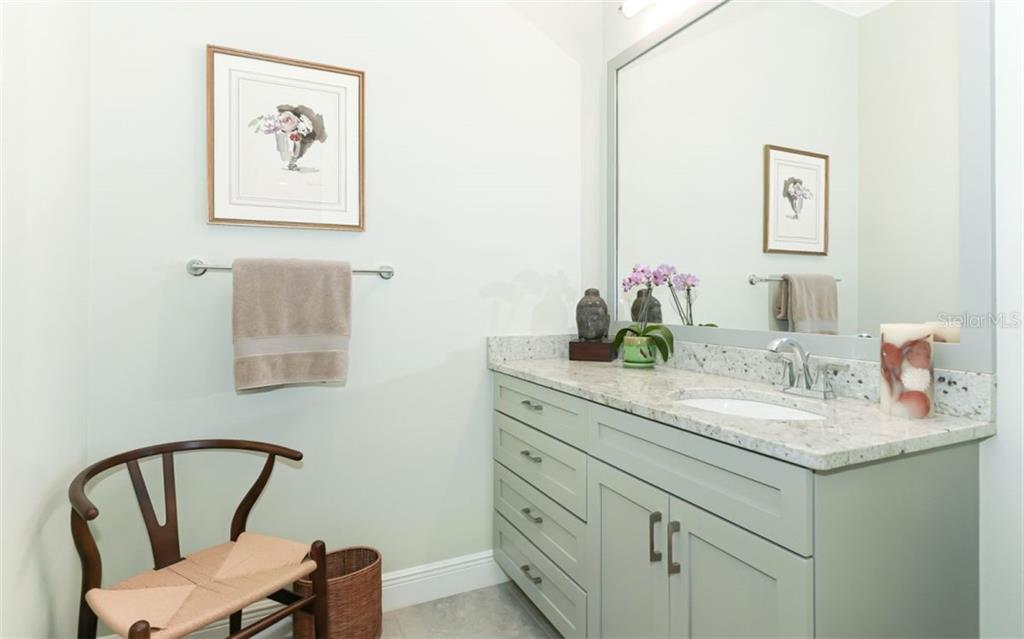 Bath for first floor bedroom;  Also features  custom walk in closet and walk in shower - Single Family Home for sale at 3538 Trebor Ln, Sarasota, FL 34235 - MLS Number is A4475545
