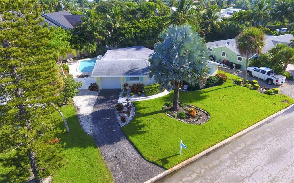 Single Family Home for sale at 410 Bay Palms Dr, Holmes Beach, FL 34217 - MLS Number is A4476011