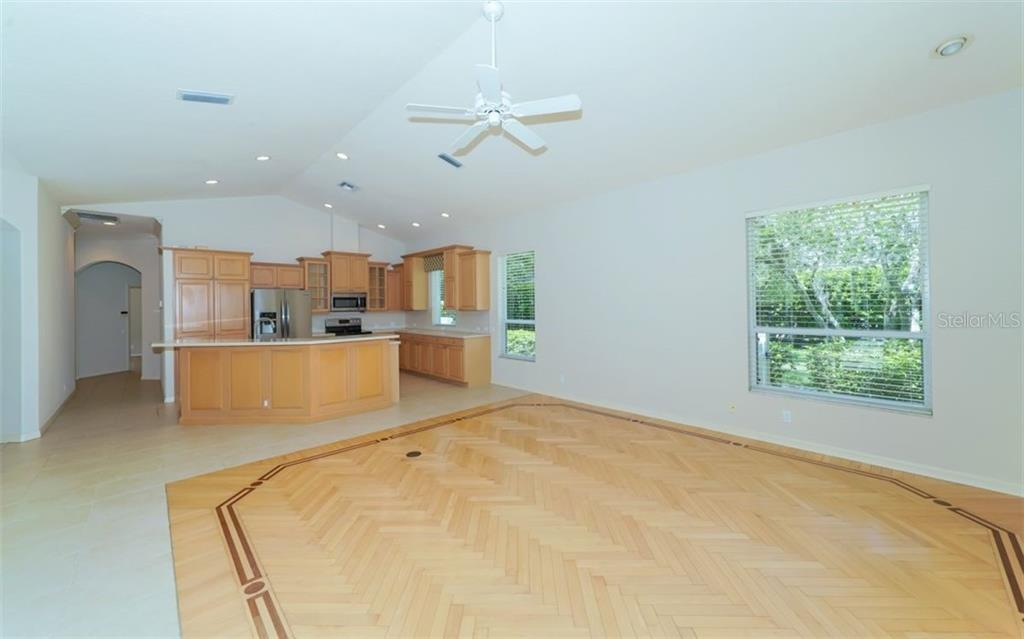 Family room to kitchen - Single Family Home for sale at 462 E Macewen Dr, Osprey, FL 34229 - MLS Number is A4476181