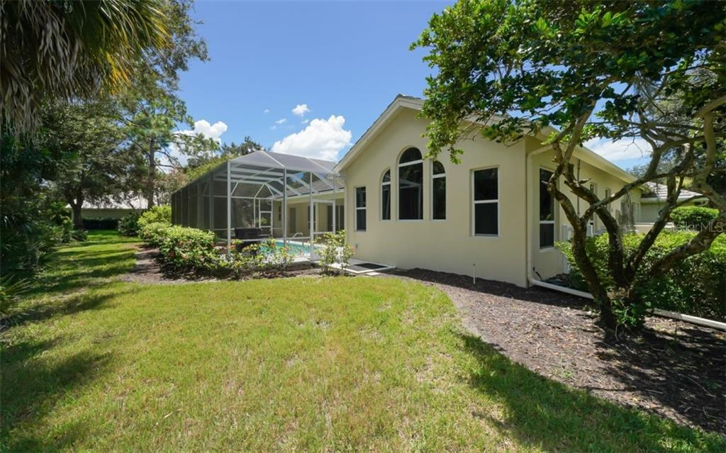 Rear exterior - Single Family Home for sale at 462 E Macewen Dr, Osprey, FL 34229 - MLS Number is A4476181
