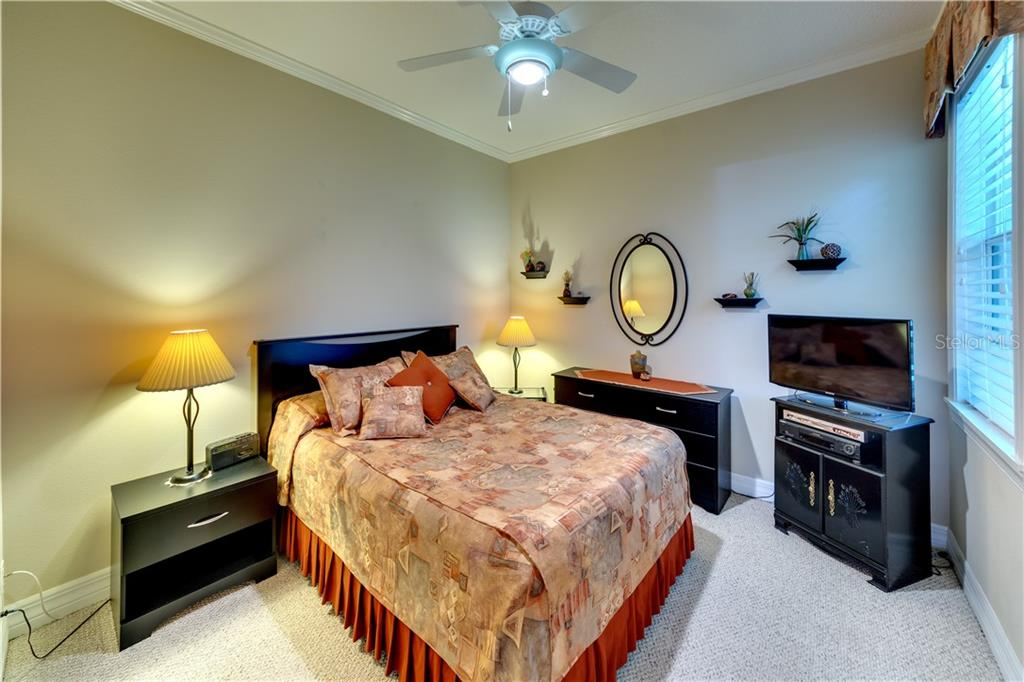Bedroom 2 - Single Family Home for sale at 701 Misty Pond Ct, Bradenton, FL 34212 - MLS Number is A4476203