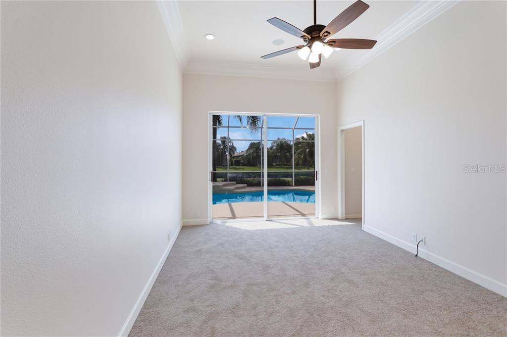 The third bedroom serves as an en-suite guest room with large walk in closet and doors to the lanai and pool. Excellent for a den, office or guest room. - Single Family Home for sale at 9618 53rd Dr E, Bradenton, FL 34211 - MLS Number is A4477826