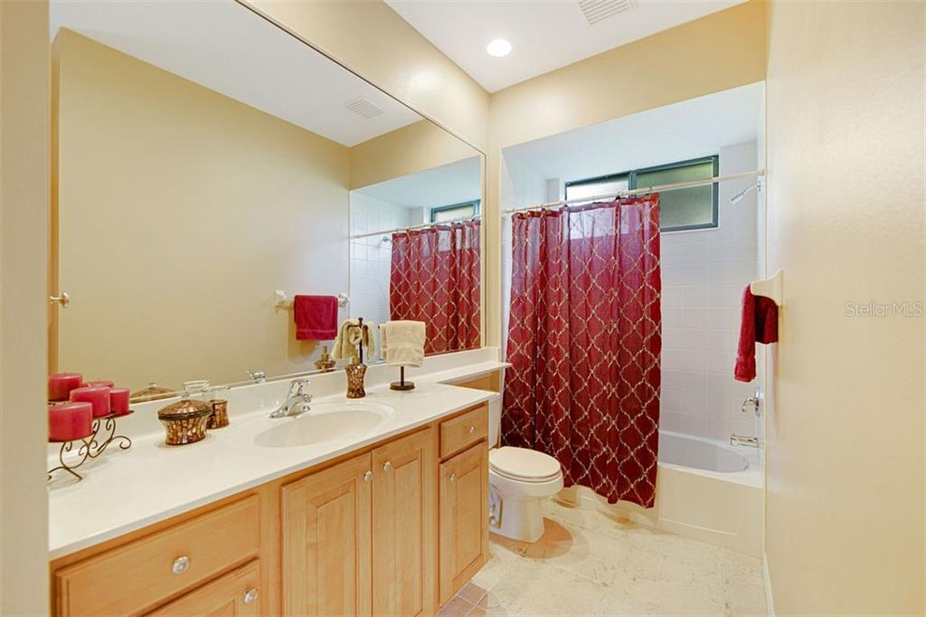 Bath 2, which serves as pool bath also. - Single Family Home for sale at 684 Crane Prairie Way, Osprey, FL 34229 - MLS Number is A4478575