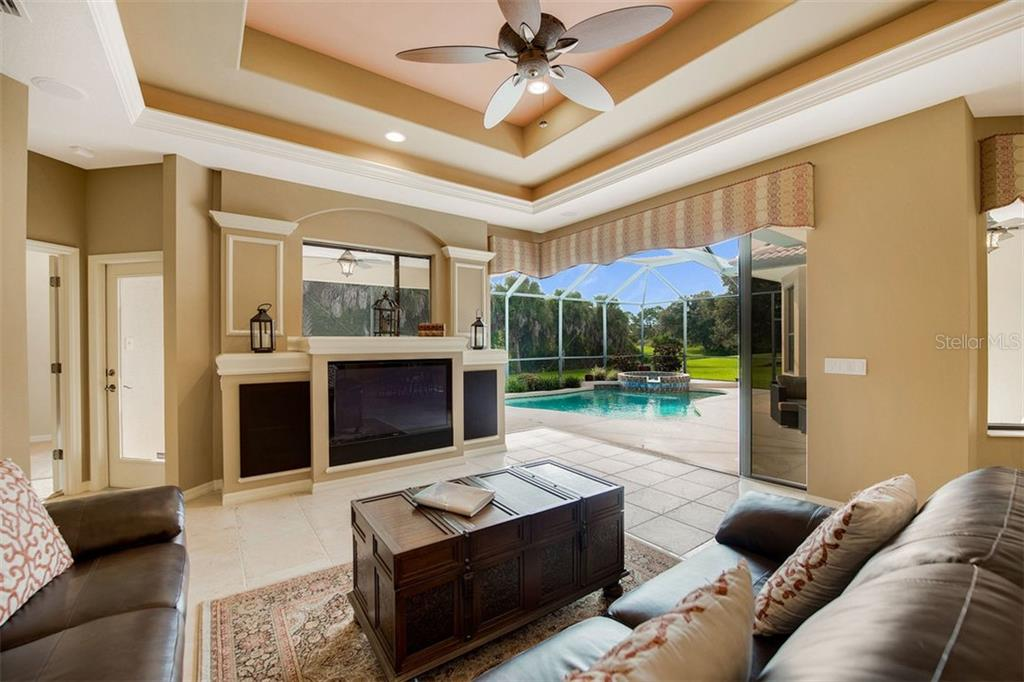Corner Pocket door for seamless indoor/outdoor living - Single Family Home for sale at 684 Crane Prairie Way, Osprey, FL 34229 - MLS Number is A4478575