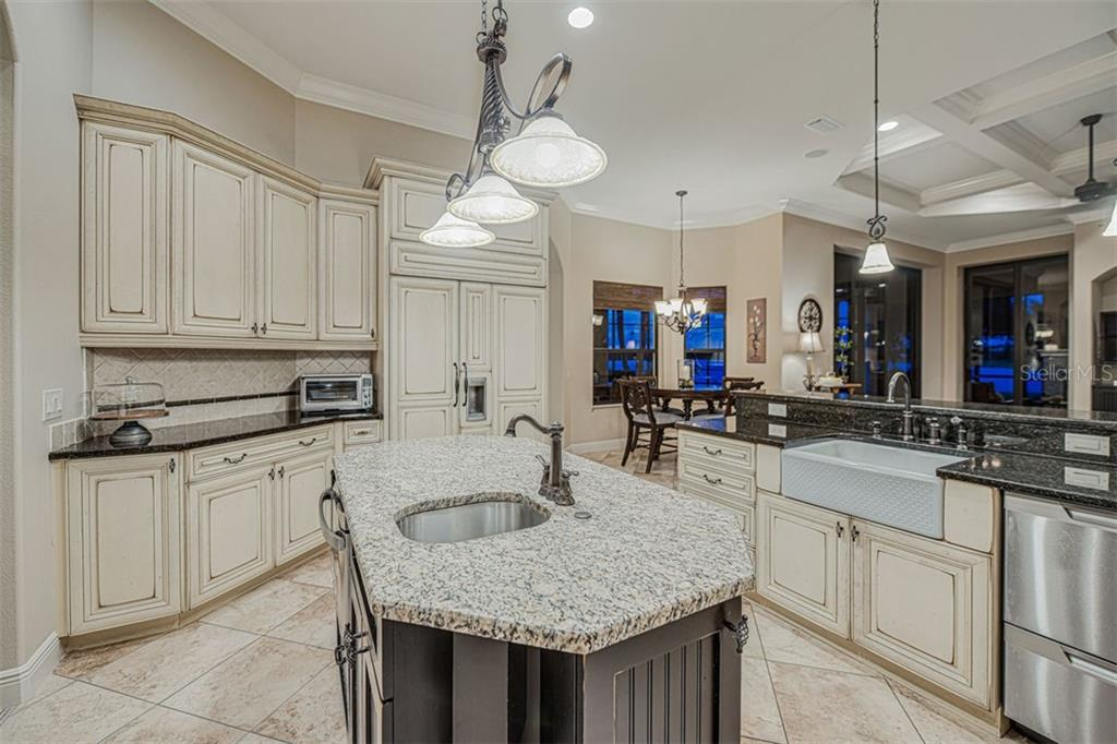 Granite counters and large farmhouse sink - Single Family Home for sale at 14507 Leopard Crk, Lakewood Ranch, FL 34202 - MLS Number is A4478709