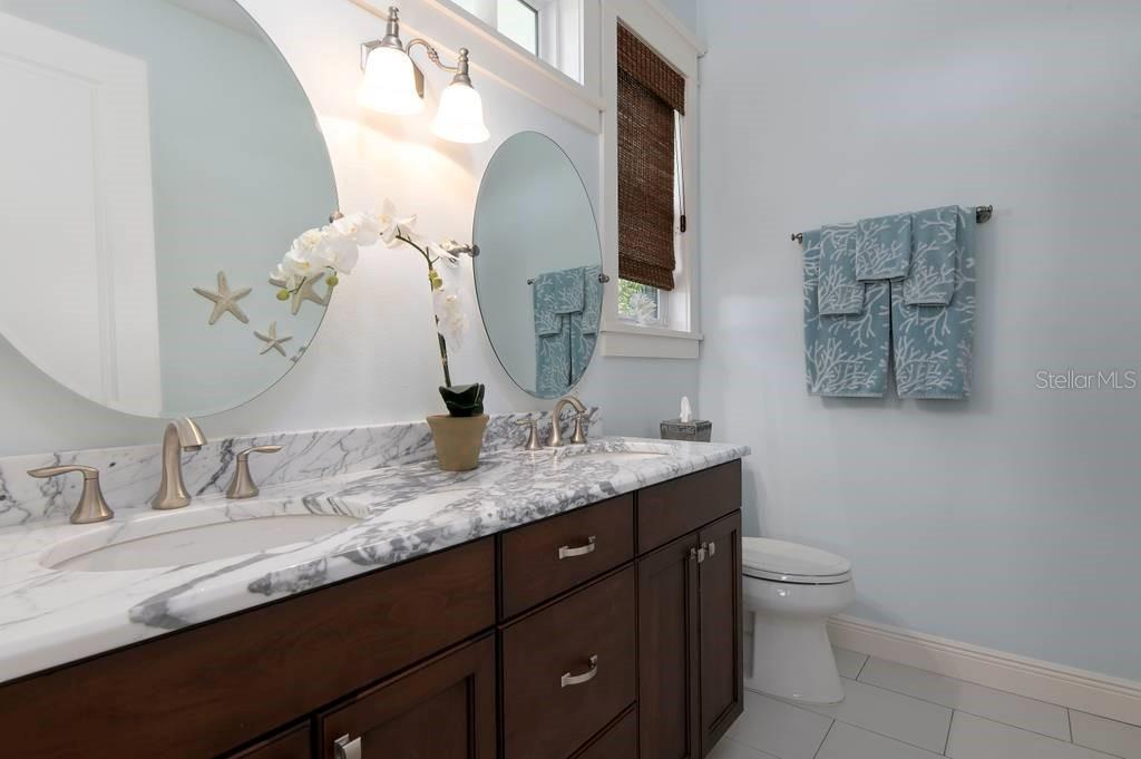 Bathroom of bedroom with patio access. - Single Family Home for sale at 718 Key Royale Dr, Holmes Beach, FL 34217 - MLS Number is A4480381