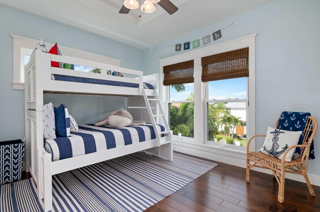 Third floor bunk room. - Single Family Home for sale at 718 Key Royale Dr, Holmes Beach, FL 34217 - MLS Number is A4480381