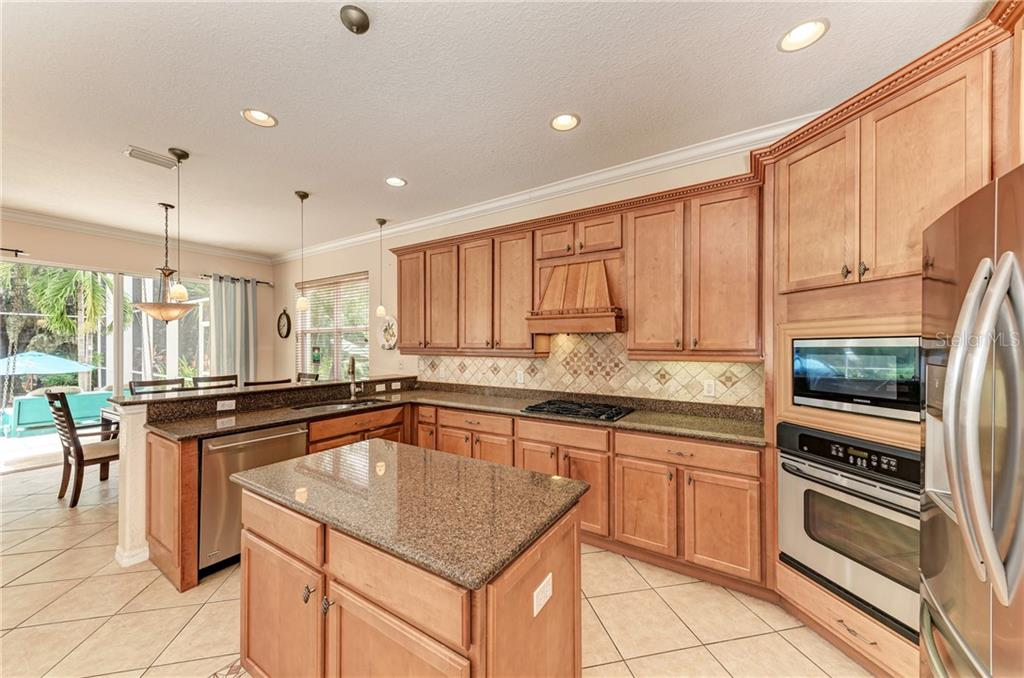 Enjoy great views of your peaceful backyard and pool area from the kitchen - Single Family Home for sale at 7118 68th Dr E, Bradenton, FL 34203 - MLS Number is A4480398