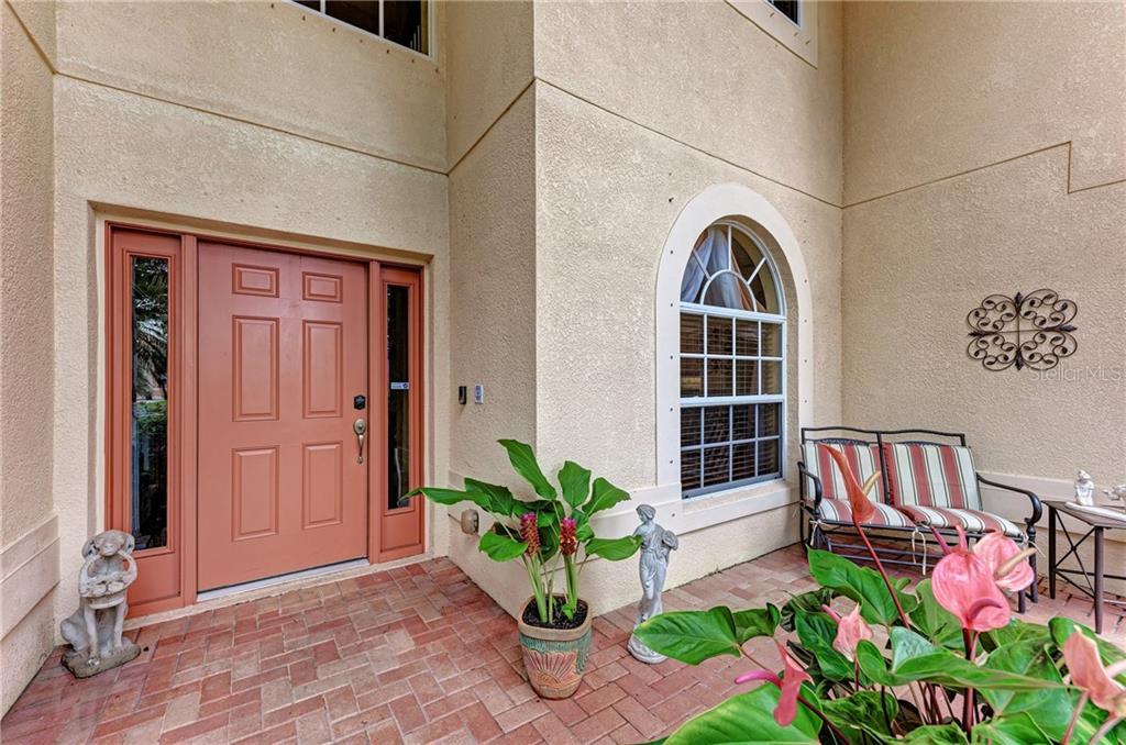 Entryway with a solid door - Single Family Home for sale at 7118 68th Dr E, Bradenton, FL 34203 - MLS Number is A4480398